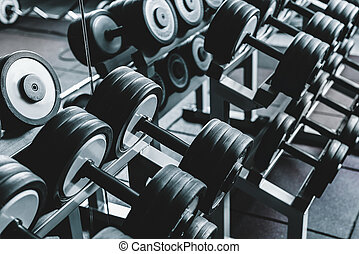 Heavy small barbells on rack - Set of middle round black...