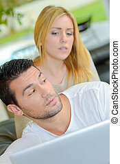 Couple surfing on-line