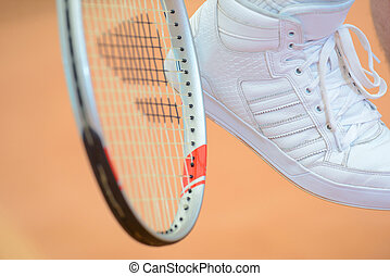 tennis racket and shoe