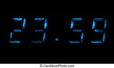 Digital clock shows the time of 23 hours 59 minutes to 00 hours 00 minutes