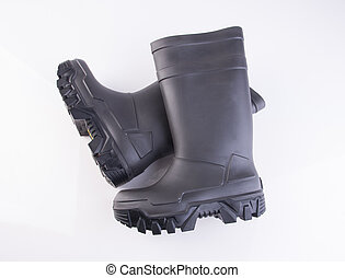 shoe or black color rubber boots on a background. - shoe or...
