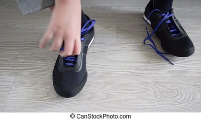 The boy running shoes is laces - The boy running shoes is a...
