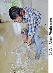 Removing floor tiles with pneumatic drill