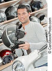 man buying helmet