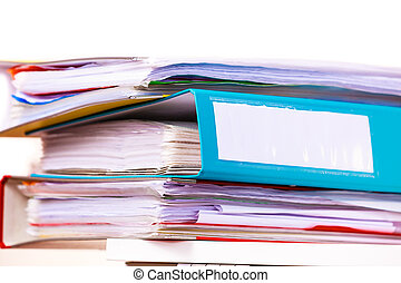 Many file folders, ring binders on office table - Paperwork....