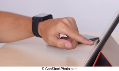 Hands typing on tablet and using smartwatch - Man's hands...