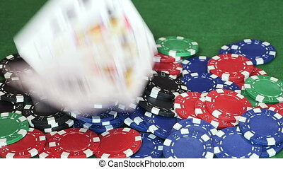 Poker cards thrown on pile of casino chips - Hand throws...