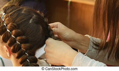 Female model getting her hair dressed