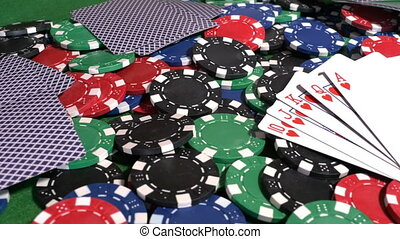 Poker cards on heap of chips - Royal flush cards of hearts...