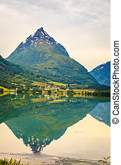 Reflection of mountains in norwegian fjord lake - Tourism...