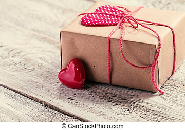 Valentines Day gift box with heart on white wooden...