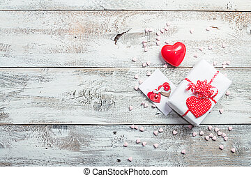 Valentines Day gift boxes with heart on white wooden...