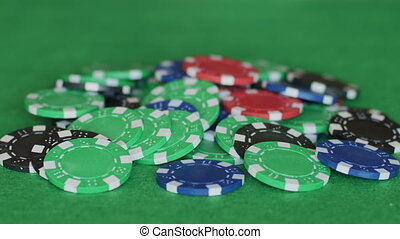 Two aces on pile of chips - First bet is made with two blue...