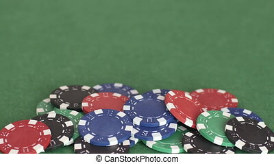 Male hands grab pile of chips