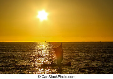 Malagasy fishing pirogue at sunset - Traditional fishing...