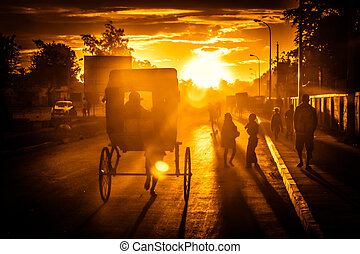 Riding rickshaw at sunset - Pousse-pousse - malagasy form of...