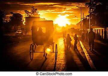 Riding rickshaw at sunset - Pousse-pousse - malagasy form of...