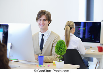 startup business, software developer working on computer at...