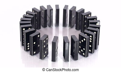 Domino blocks in circle fall down - Circle of black dominoes...