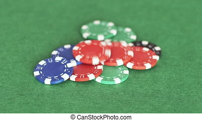 Chips thrown on pile - Casino tokens thrown on pile from...