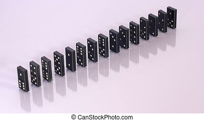 One domino knocks down whole line - Black domino blocks fall...