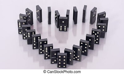 Dominoes heart destroyed and rebuilt - Heart built of domino...