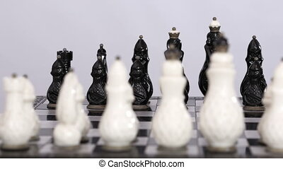 Chess figures set up for game - White and black chess set up...