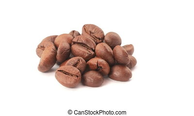 Isolated coffee beans - Roasted coffee beans on heap, white...