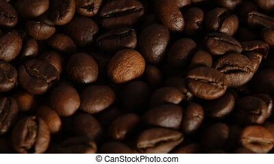 Roasted coffee beans - Brown coffee seeds fill up space,...
