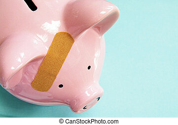 pink piggy bank with a bandage (healthcare costs)