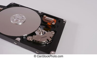 Three hard drives - Three data storage devices lying on...