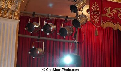 Theater lights. Red background. Sources of light