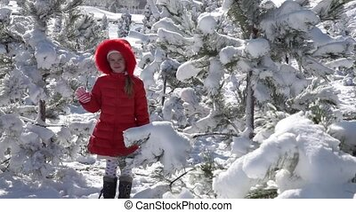 Little girl playing with snowballs
