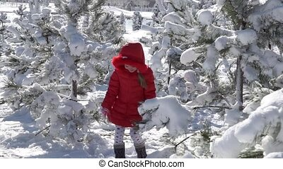 Little girl playing with snowballs. Slow motion 60 fps