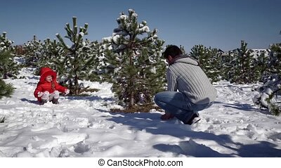 Little girl with father playing with snowballs - Little girl...