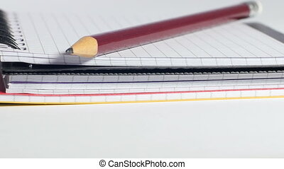 Workplace of accountant - Pencil lying on top of notebook,...