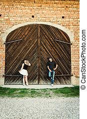 ouple stands before old door