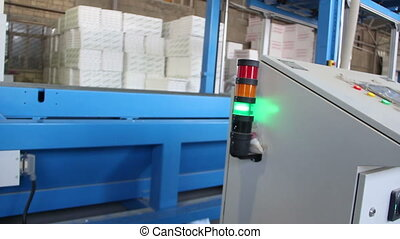 Flasher light of control panel of a conveyor in styrofoam...