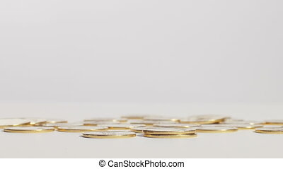 Saving up money - Gold coins scattered around on blurred...
