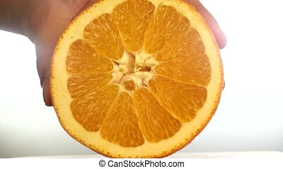 Close-up of hand cut orange 4K
