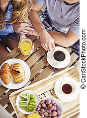 Directly above shot of couple during breakfast