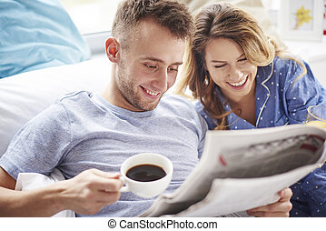 Morning news on the paper makes couple laugh