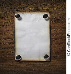 note paper on wooden wall business - close up of grunge note...