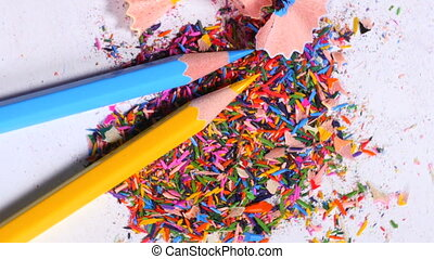 Blue and yellow pencils on pile of leftovers - Yellow and...