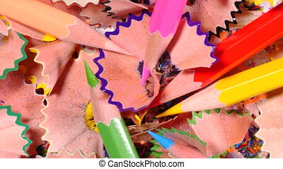 Pencils lying in pile of pencil chips - Sharpened bright...