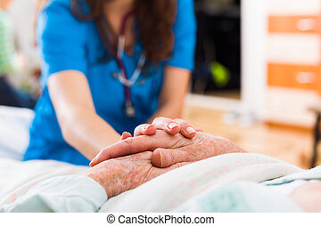 Elderly patient in need - Senior woman in the nursing home...