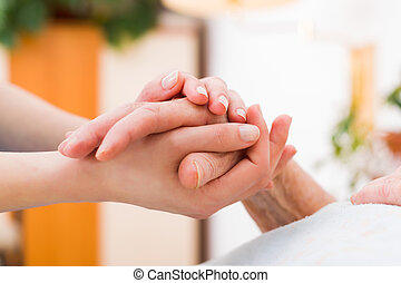 I'm with you no matter what - Nurse holding the hand of an...