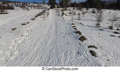 beautiful snowy landscape with rolled road shot from...