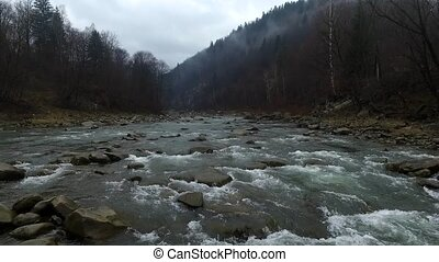 mountain river running throung cliffs in Carpathians, shoot...