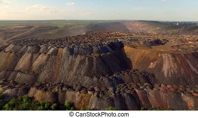 rock dumps from quarries - landscape with multicolored rock...